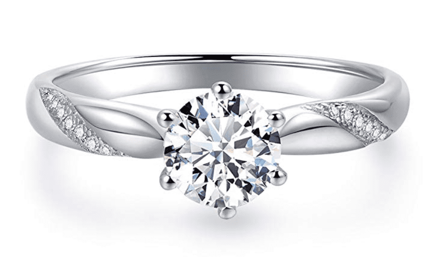 give a stunning flame solitaire engagement ring