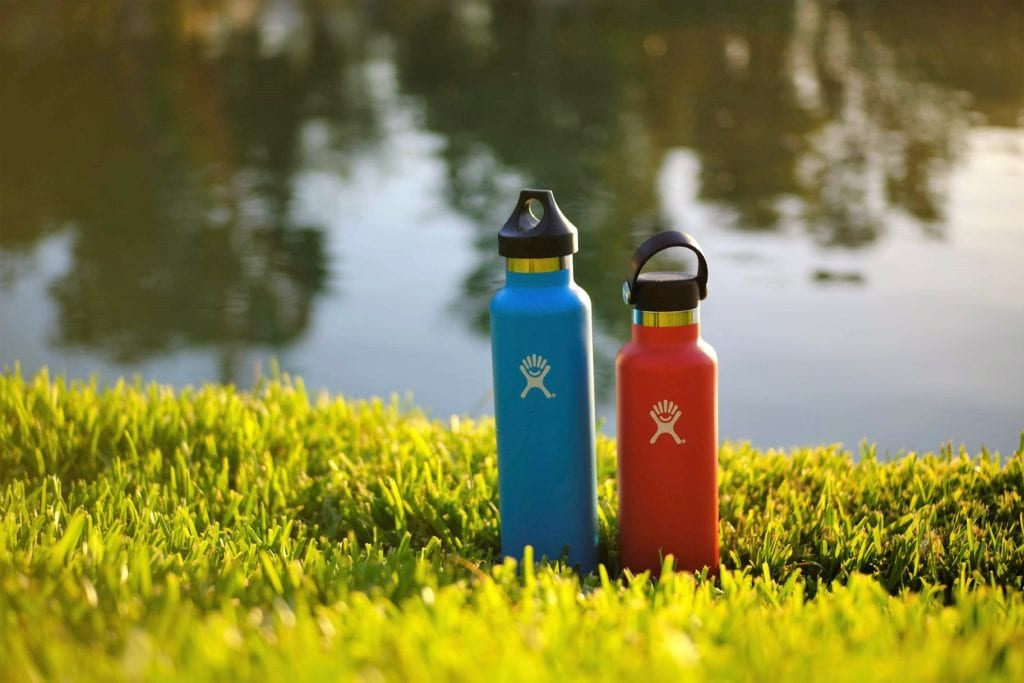 Insulated water bottles on grass