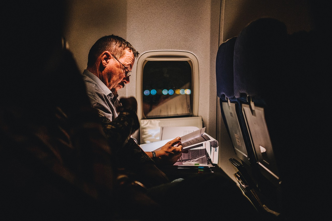 reading and keeping busy are great tips for surving long flights