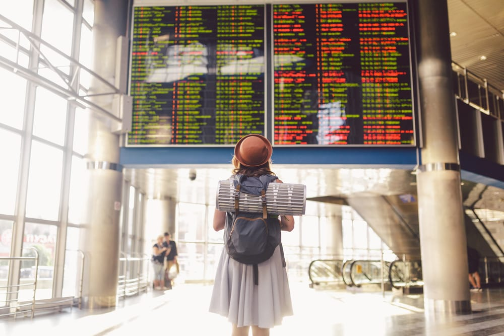 young woman standing in an airport