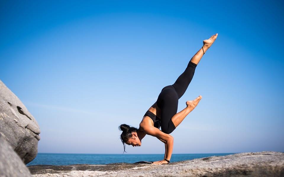 woman doing outdoor yoga