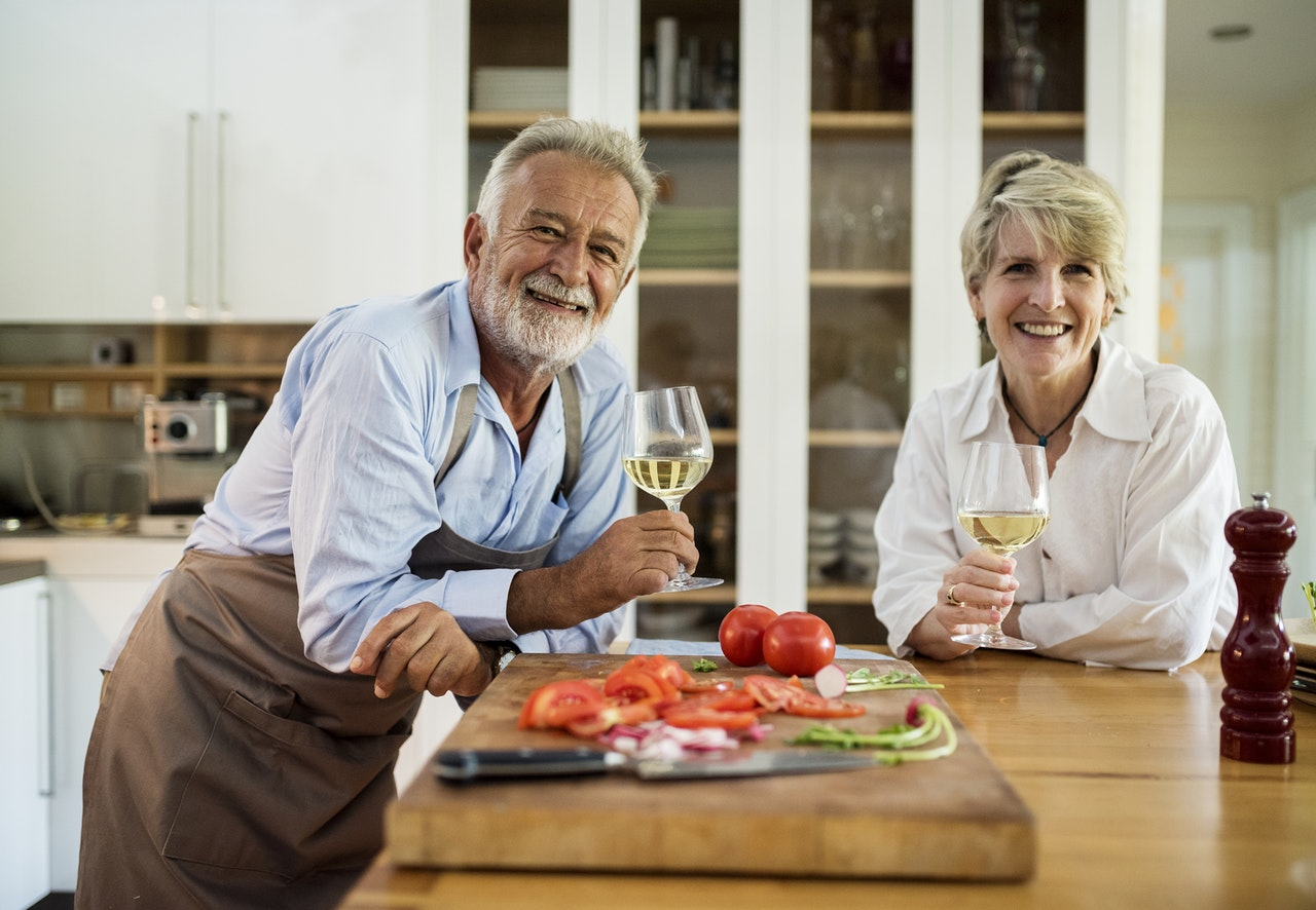 couple cooking a romantic dinner at home together