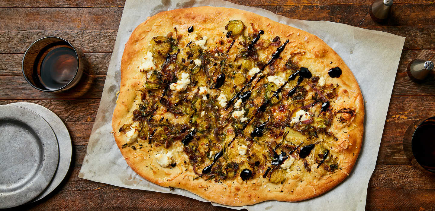 white pizza with crispy brussels sprouts and balsamic glaze