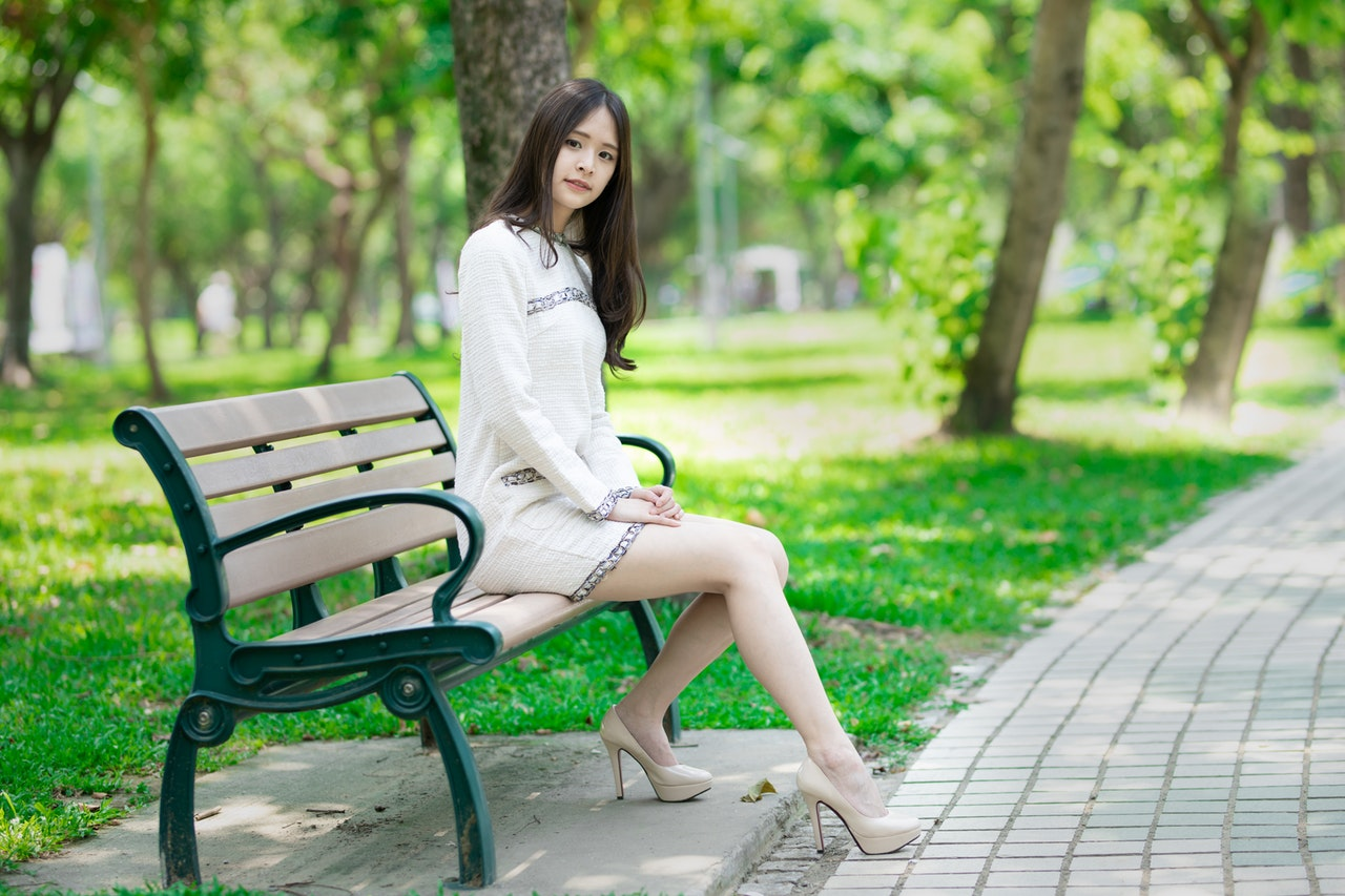 woman sitting on a bench with beautiful posture