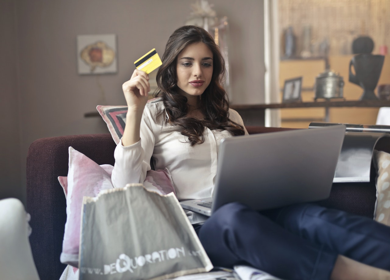 woman using her store credit to go shopping