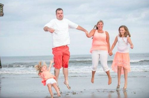 awkward moment when you try to get a family photo on the beach