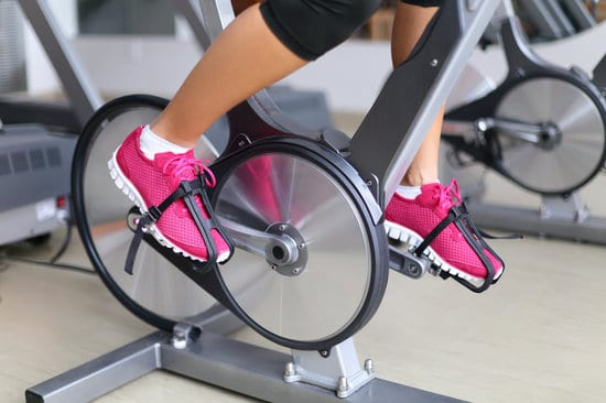 Exercise bike with spinning wheels