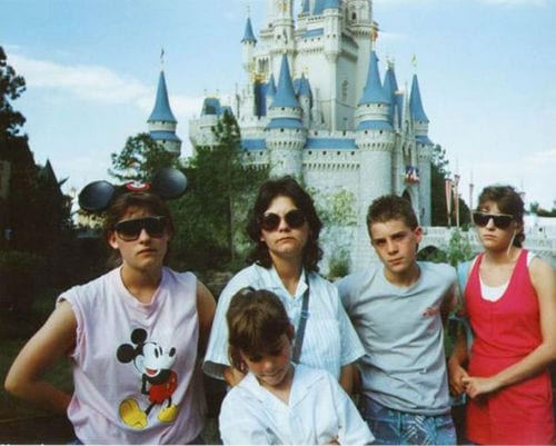 family looking really unhappy about their vacation to disneyland