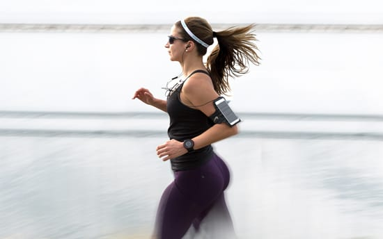 woman running with workout accessories on