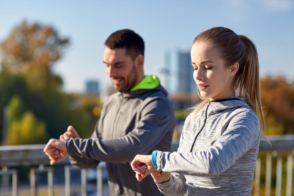 man and women with fitness trackers