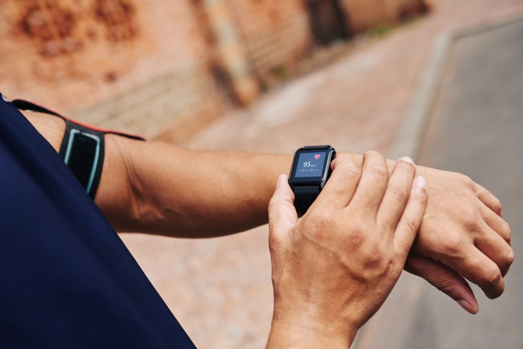 man with fitness tracker on wrist