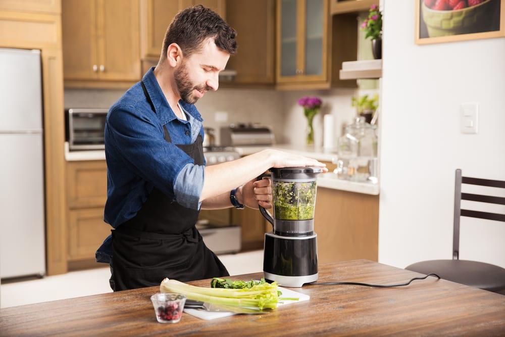man using a food processor