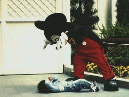 mickey mouse scaring a child
