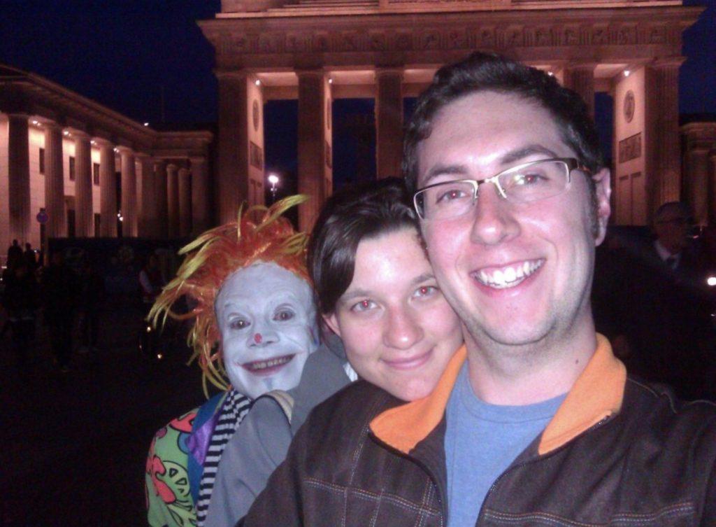 scary clown photobombs couple