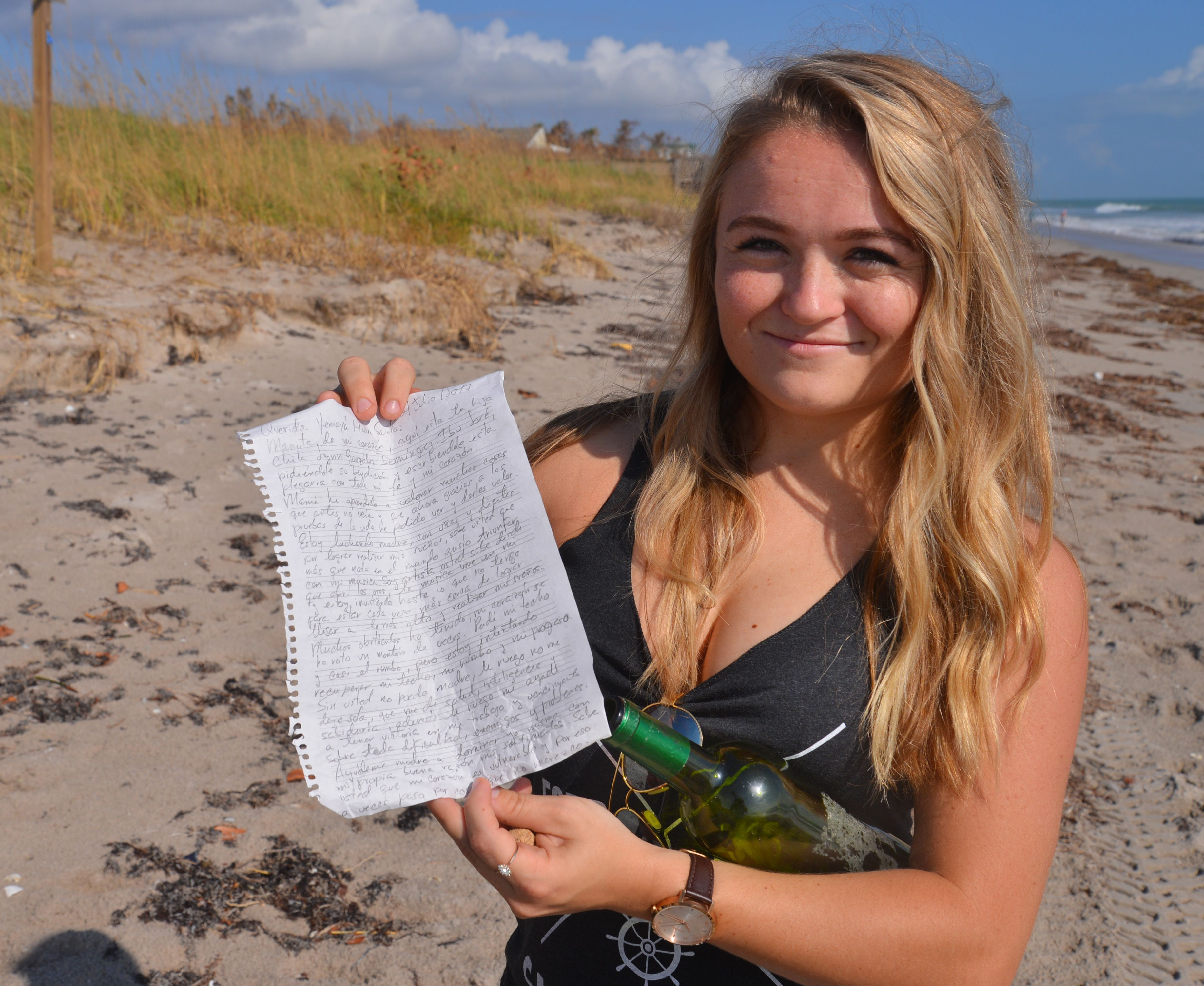 Nikki Snow reads message in bottle