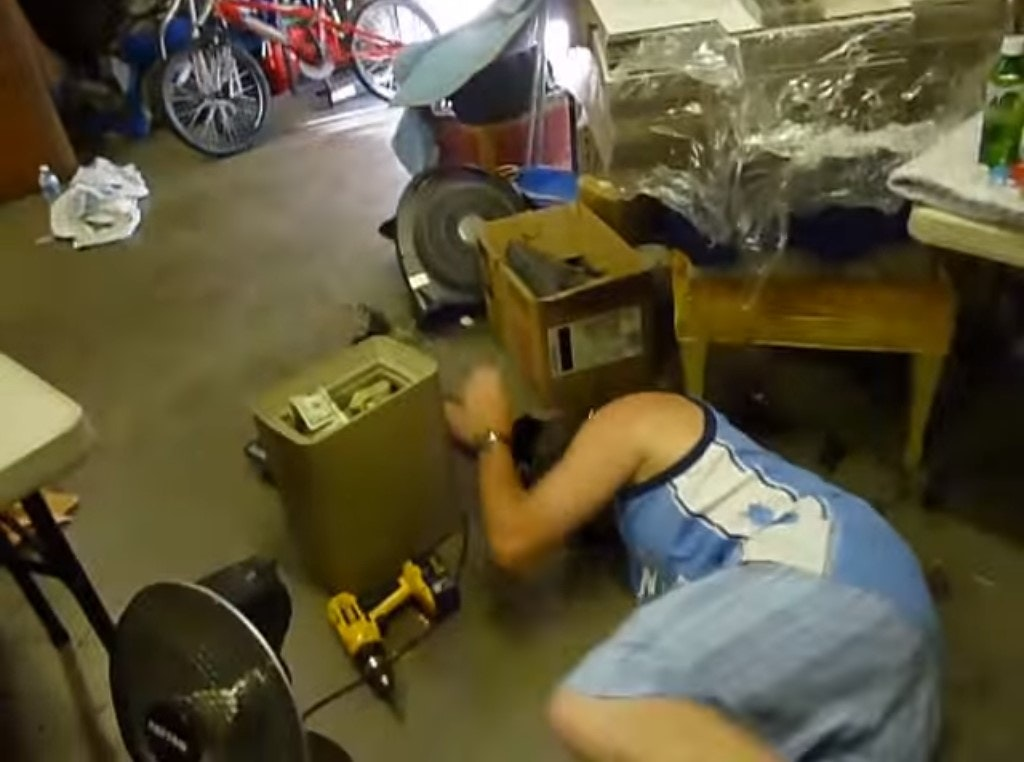opening the storage unit with a drill