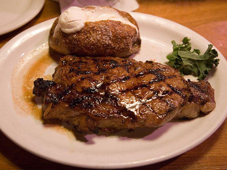a steak dinner on the table