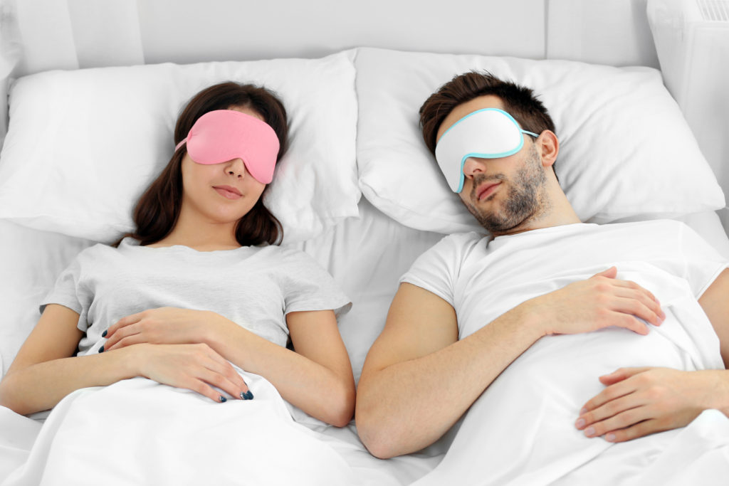 couple with sleep masks on