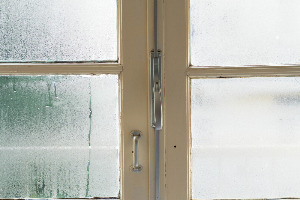 foggy window in home signs you need a dehumidifier