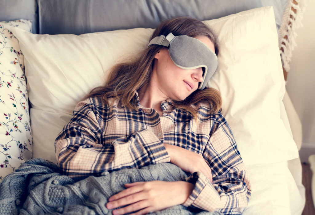 Women sleeping with sleep mask
