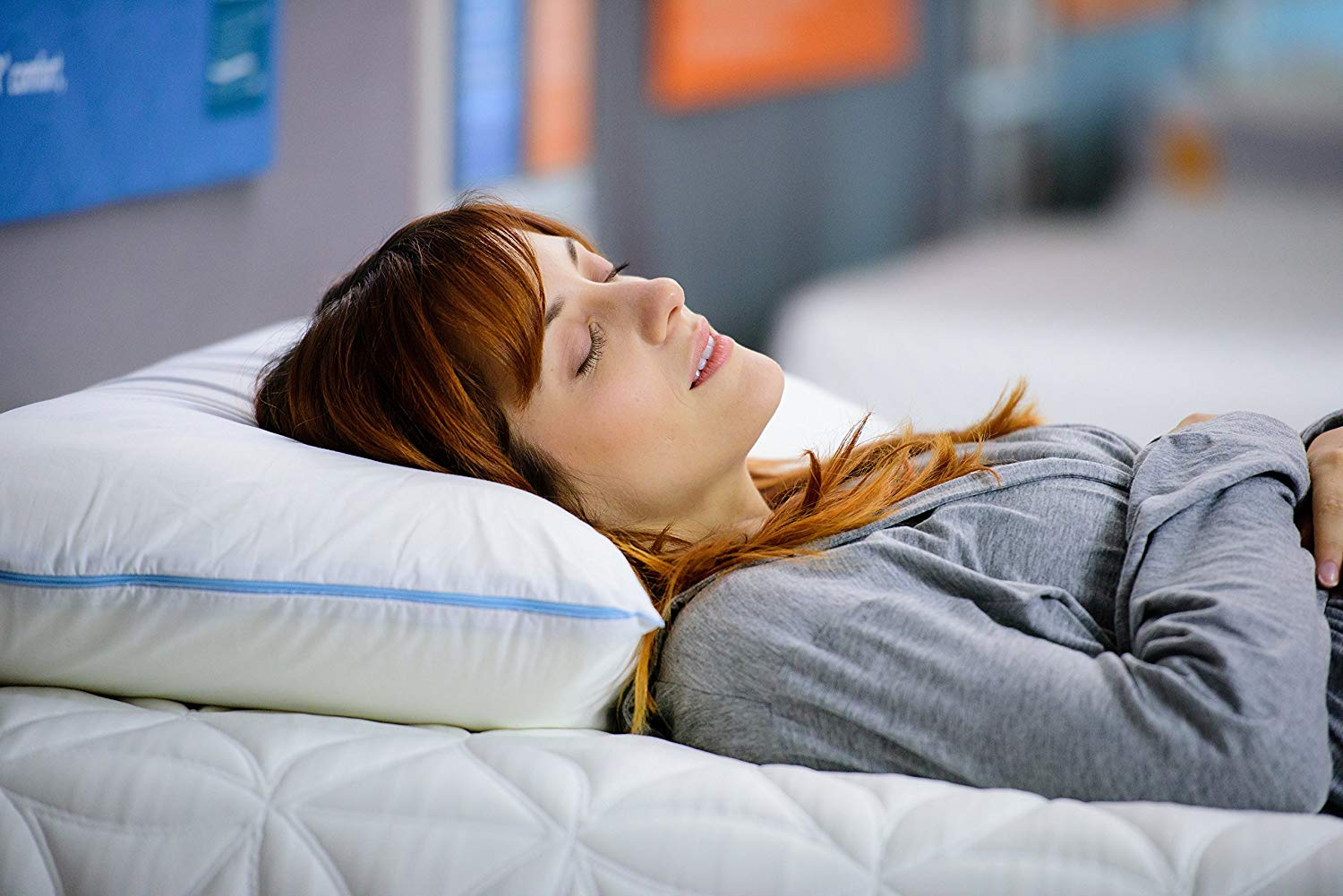 Woman lying on memory form pillow