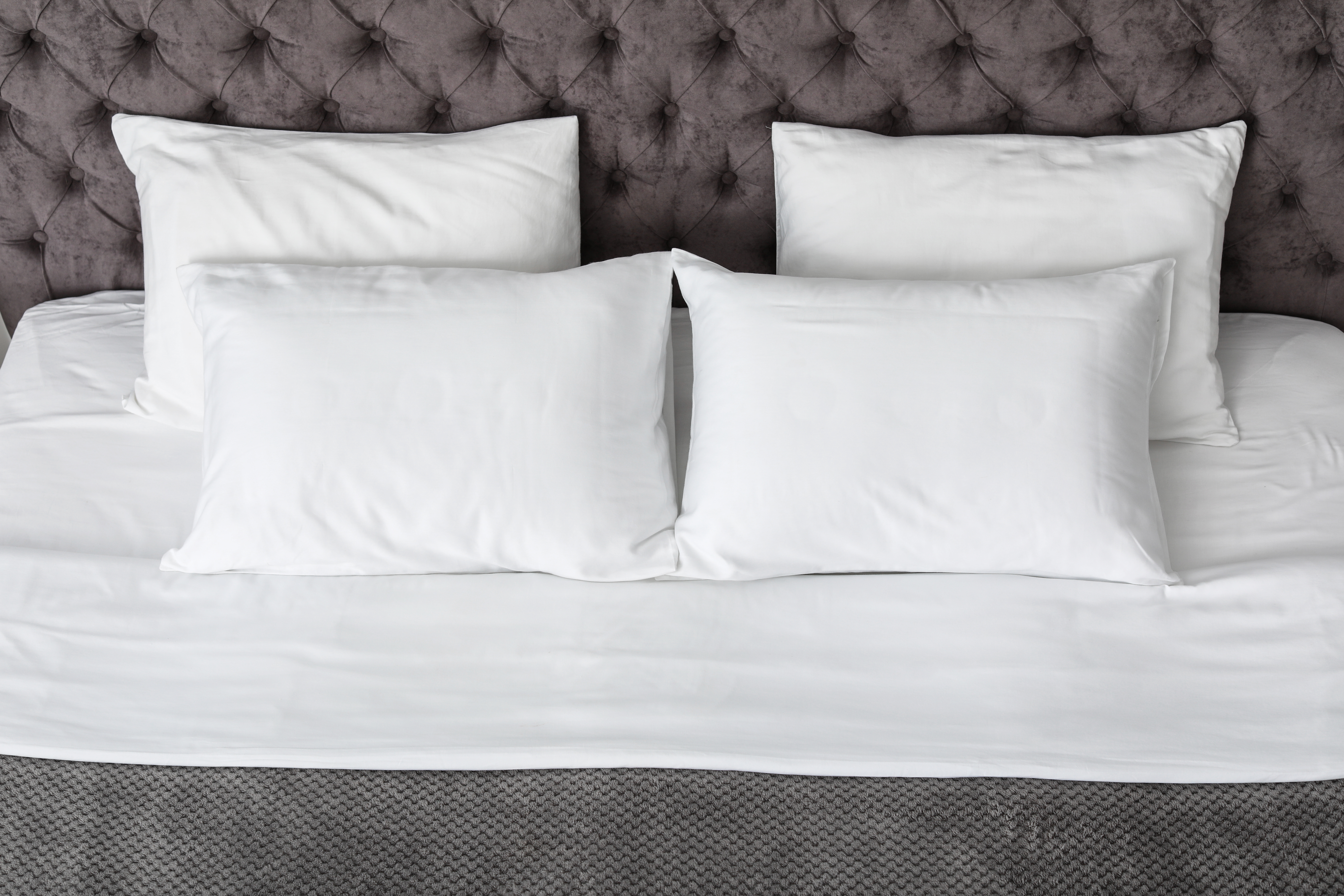 4 pillows on a bed