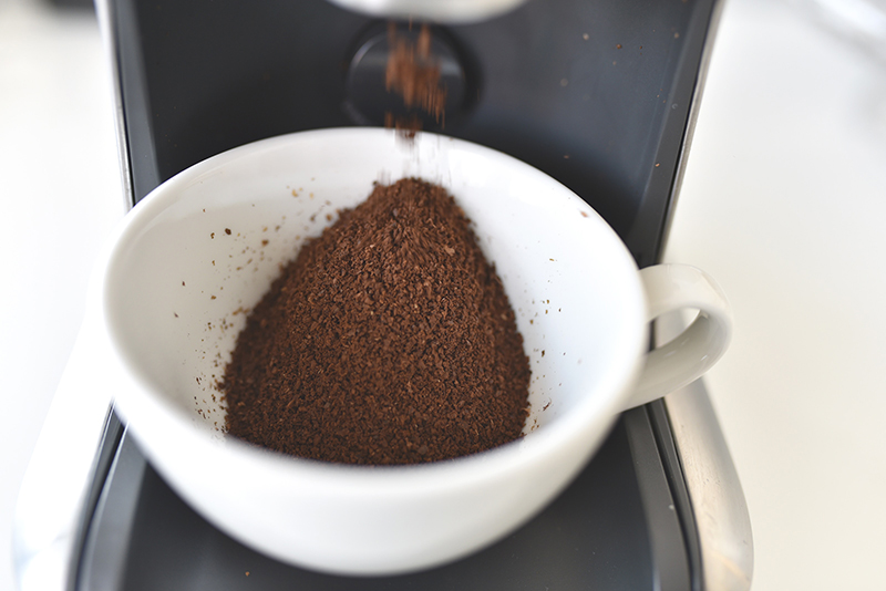 coffee grounds in a white mug