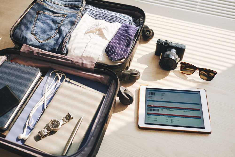 packing hacks for business travelers open suitcase