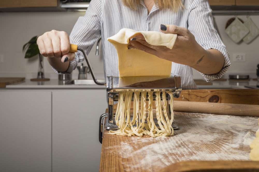 woman preparing homemade pasta