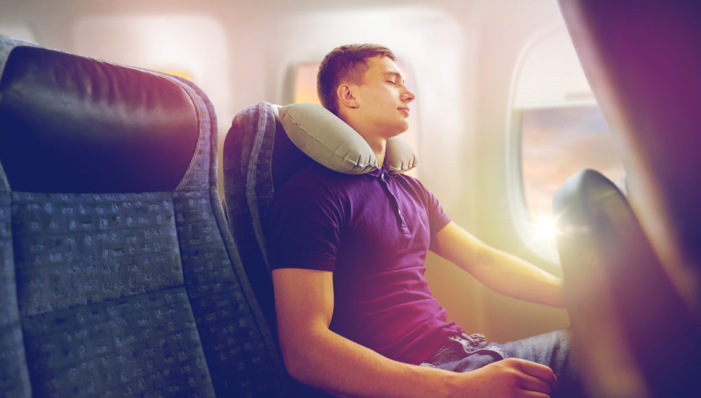 resting on a plane with travel pillow