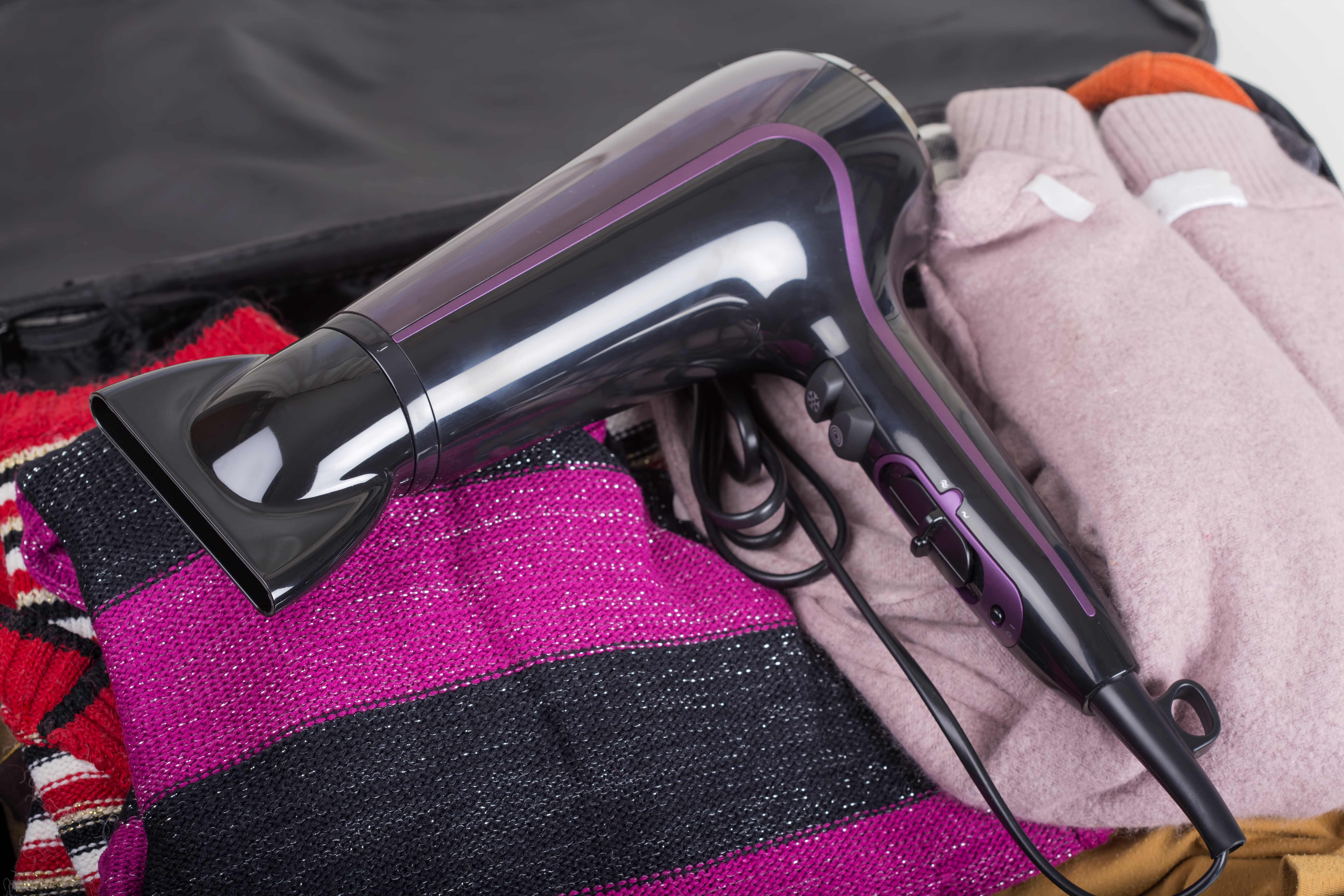 travel hair dryer in suitcase