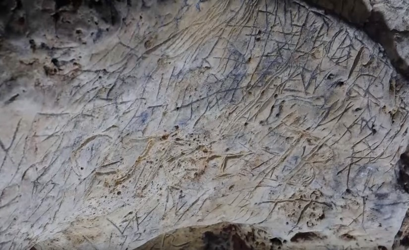 hundreds of markings inside the cave