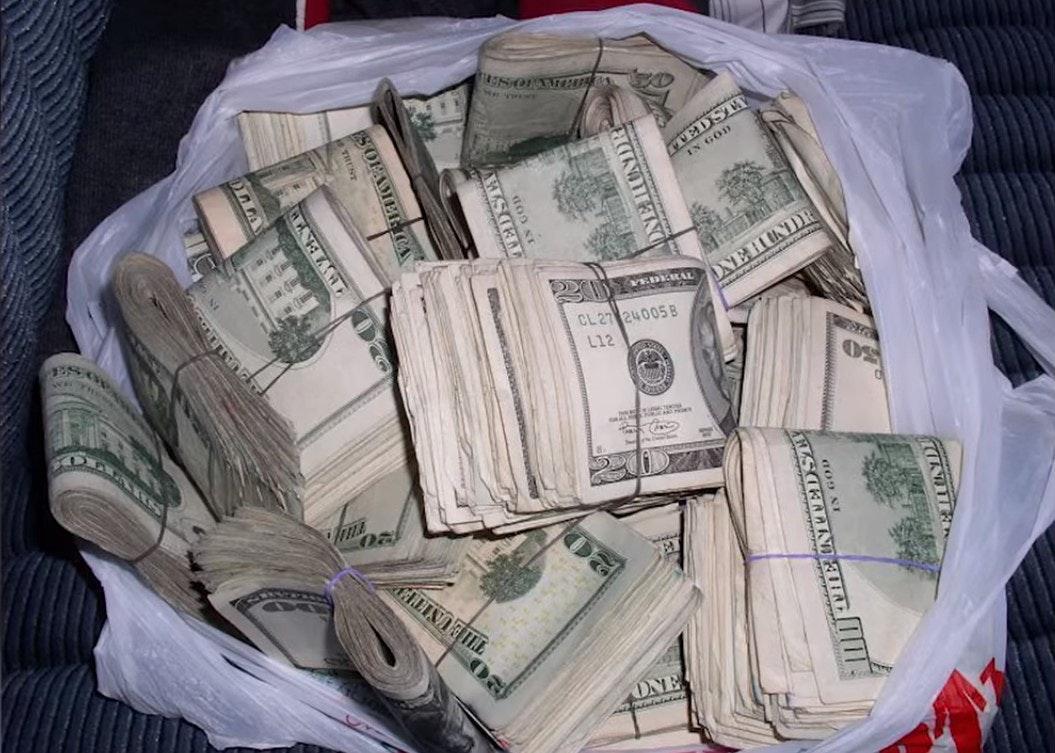 large amount of money in storage unit