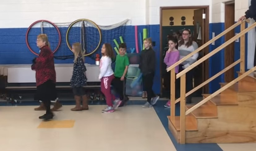 pupils line up for surprise for janitor