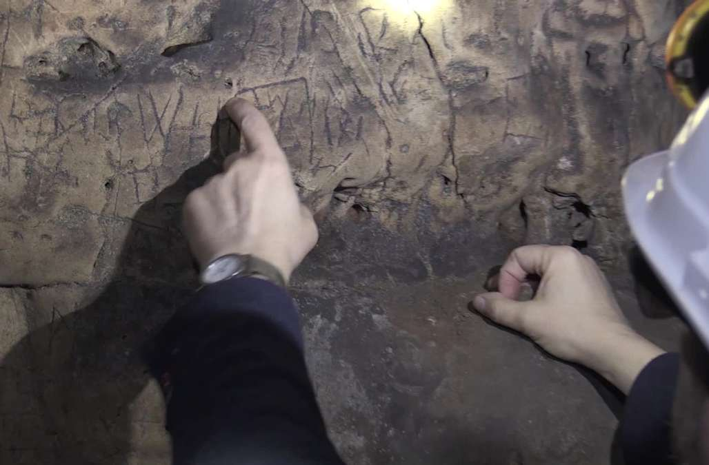 the marks inside cave were not graffiti