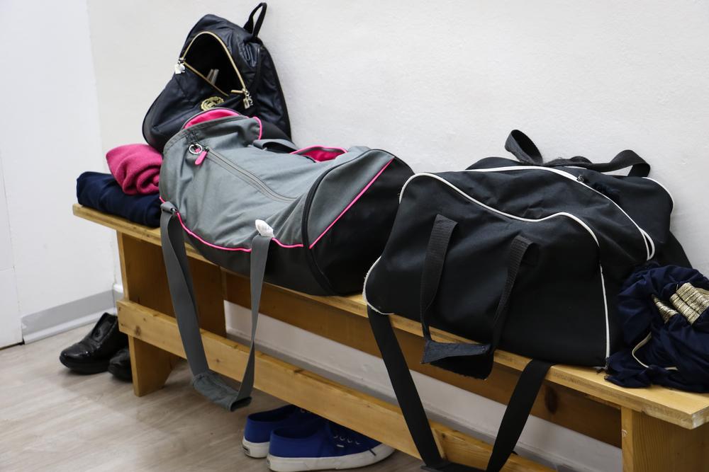 gym bags in a locker room