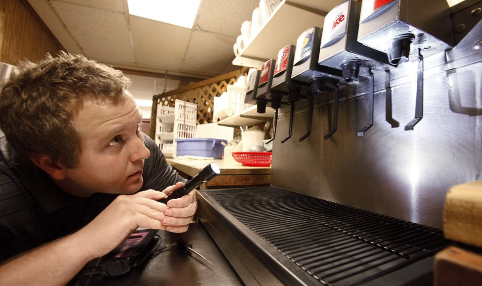 health inspector inspecting coffee dispensers