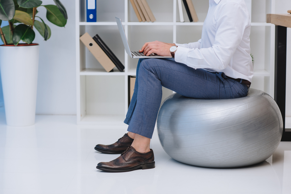 man laptop exercise ball