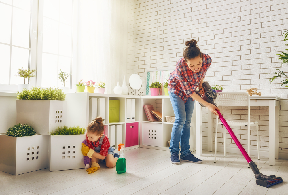 mom and daughter cleaning home