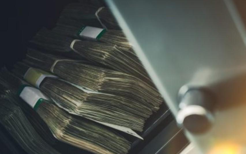 wads of bills in the storage unit