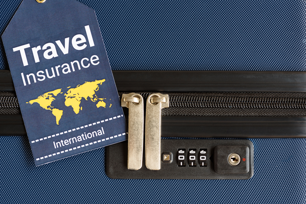 travel insurance packet on suitcase