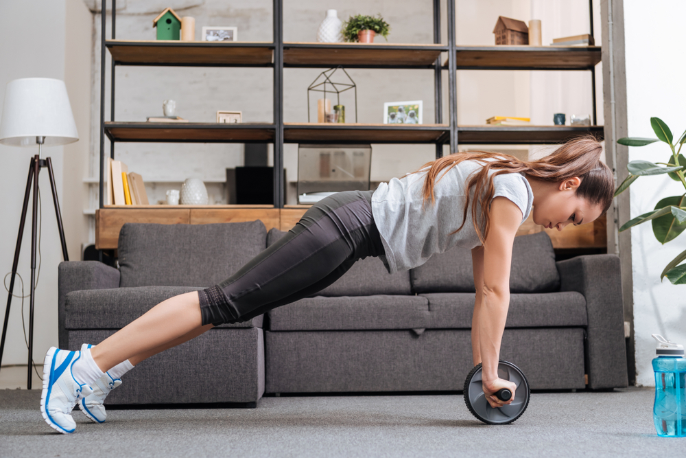 woman using an ab wheel