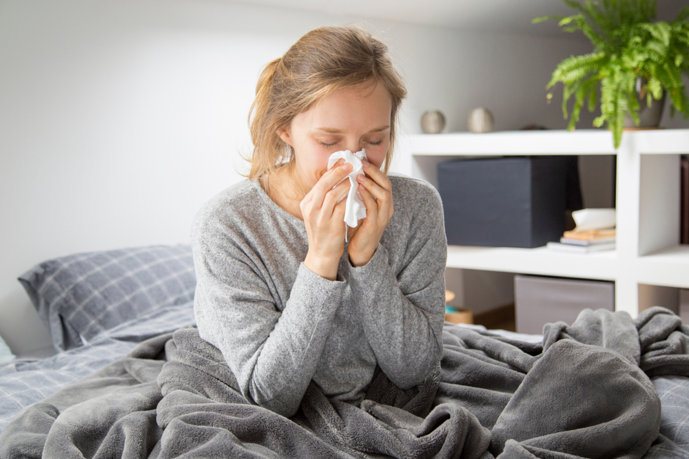 woman with allergies in bed