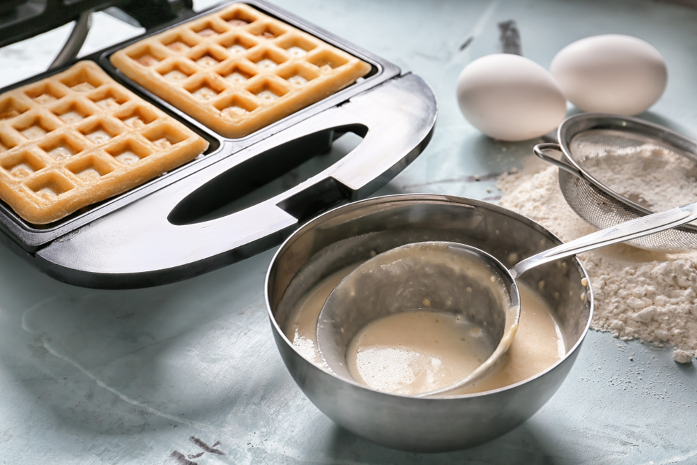 baking a waffle in a waffle maker