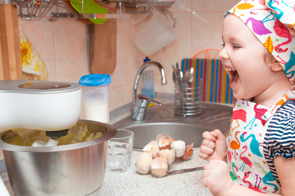 child mixing ingredients in a food processor