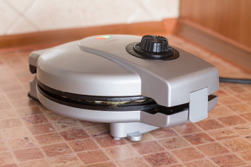 closed waffle iron on counter