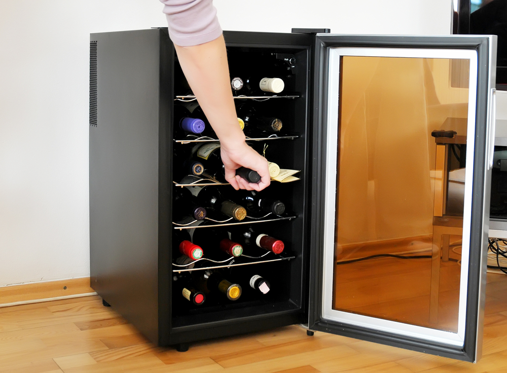 hand in wine fridge
