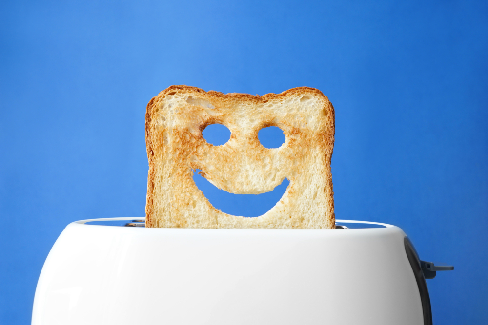 happy bread in a toaster