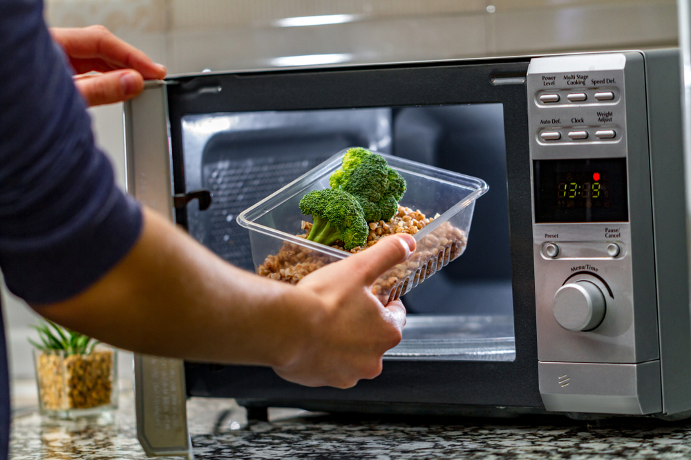 heating up lunch in a microwave oven