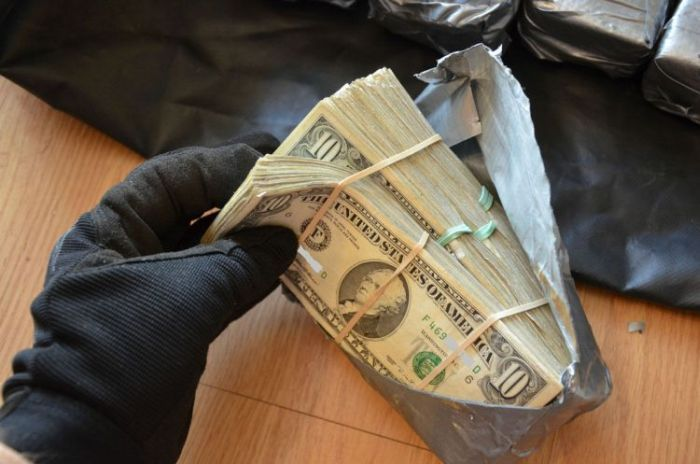man counting cash found in car
